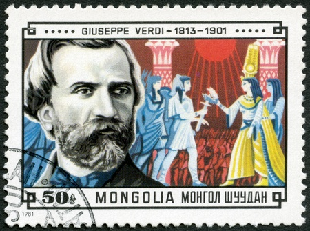 MONGOLIA - CIRCA 1981: A stamp printed in Mongolia shows Giuseppe Verdi (1813-1901) and Scene from his Aida, circa 1981 photo