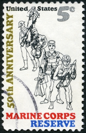 USA - CIRCA 1966: A stamp printed in USA shows Combat Marine, 1966; Frogman; WW II Flier; WW I  photo