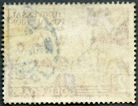 The reverse side of a postage stamp on a black background Stock Photo - 16810154