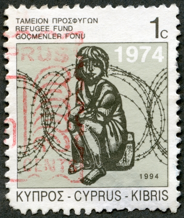 kypros: CYPRUS - CIRCA 1994: A stamp printed in Cyprus shows Child and Barbed Wire, Refugee Fund, circa 1994