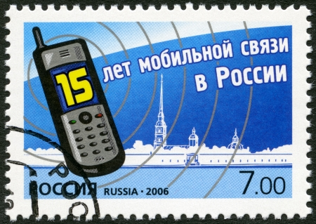 landlines: RUSSIA - CIRCA 2006: A stamp printed in Russia shows mobile phone, devoted The 15th anniversary of mobile communication in Russia, circa 2006 Stock Photo