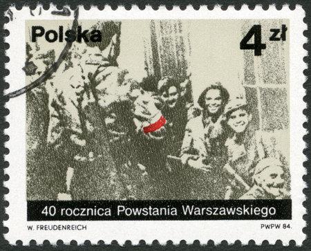 batallón: POLONIA - CIRCA 1984: Un sello impreso en Polonia muestra partisanos polacos del batallón Miotla de la Armia Krajowa, foto tomada por Jerzy Tomaszewski, el 2 de septiembre de 1944, aniversario dedicado 40 años de la Sublevación de Varsovia, alrededor del año 1984 Editorial