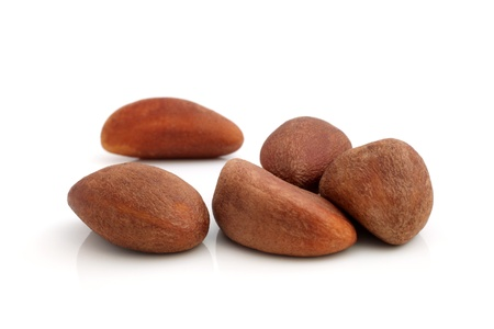Brazil nuts on a white background photo