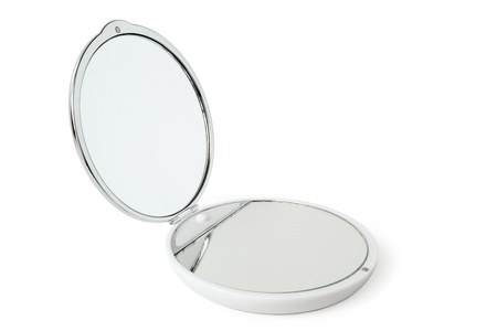 light complexion: Round cosmetic mirror on a white background Stock Photo