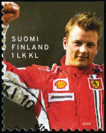 racer flag: FINLAND - CIRCA 2008: A stamp printed in Finland shows Kimi Raikkonen F1 World Champion 2007, Motor racing, circa 2008