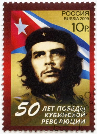 RUSSIA - CIRCA 2009  A stamp printed in Russia shows commander Ernesto Guevara de la Serna  Che Guevara  and the Republic of Cuba national flag, the 50th anniversary of the Cuban revolution Victory, circa 2009