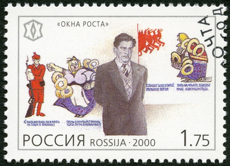 national poet: RUSSIA - CIRCA 2000: A stamp printed in Russia shows Vladimir V. Mayakovsky (1893-1930), poet, and propaganda posters, series National Cultural Milestones in the 20th Century, circa 2000