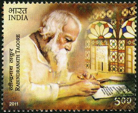 overprint: INDIA - CIRCA 2011: A stamp printed in India shows Rabindranath Tagore (1861-1941), Indian poet, circa 2011