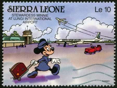 minnie mouse: SIERRA LEONE - CIRCA 1990: A stamp printed in Sierra Leone shows stewardess Minnie Mouse at Lungi International Airport, Walt Disney Characters, circa 1990 Editorial