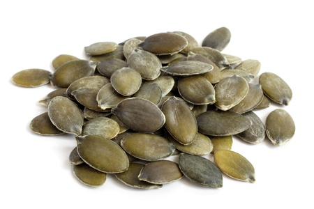 Pumpkin seeds on a white background photo