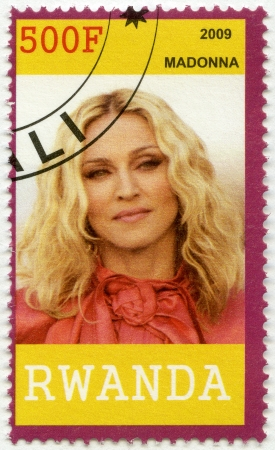 madonna: RWANDA - CIRCA 2009: A stamp printed in Republic of Rwanda shows Madonna Louise Ciccone, circa 2009
