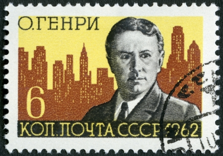 henry: USSR - CIRCA 1962: A stamp printed in USSR shows O. Henry and New York Skyline (William Sidney Porter, 1862-1910), American writer, circa 1962 Editorial