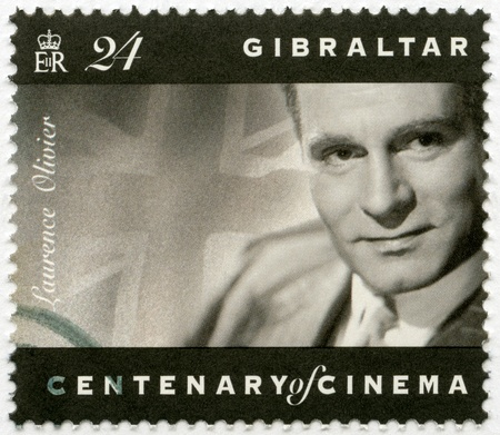 laurence: GIBRALTAR - CIRCA 1995: A stamp printed in Gibraltar shows Laurence Olivier (1907-1989), actor, director, and producer, circa 1995 Editorial