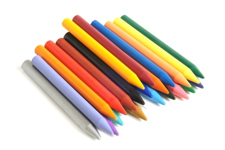 Colored wax pencils on white background photo