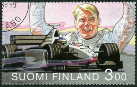 racecar: FINLAND - CIRCA 1999: A stamp printed in Finland shows Mika Hakkinen, Formula 1 Driving Champion 1998, circa 1999