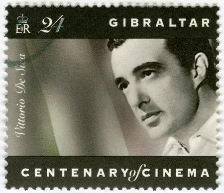 vittorio: GIBRALTAR - CIRCA 1995: A stamp printed in Gibraltar shows Vittorio De Sica (1901-1974), director, actor, circa 1995