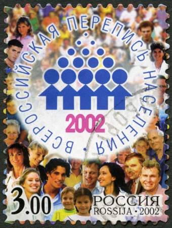 postmail: RUSSIA - CIRCA 2002: A stamp printed in Russia shows Emblem and people, devoted All-Russian population census 2002, circa 2002
