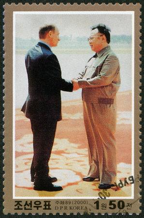 il: NORTH KOREA - CIRCA 2000: A stamp printed in North Korea shows Kim Jong Il and President Putin, Visit of Kim Jong Il to Russia, circa 2000