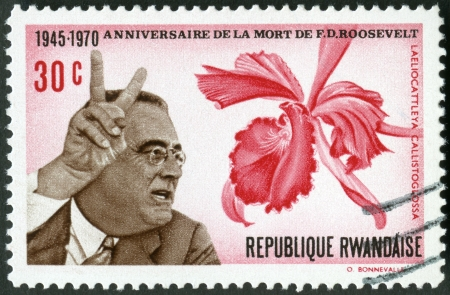RWANDA - CIRCA 1970: A stamp printed in Rwanda shows President Franklin D. Roosevelt (1882-1945) and orchid, 25th death anniversary, circa 1970 Stock Photo - 17839122