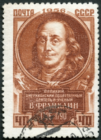 satirist: USSR - CIRCA 1956: A stamp printed in USSR shows Benjamin Franklin (1706-1790), series Great personalities of the world, circa 1956 Editorial