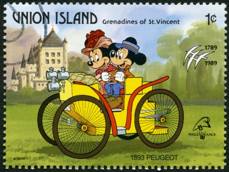 mickey: ST. VINCENT GRENADINES - UNION ISLAND - CIRCA 1989: A stamp printed in St. Vincent Grenadines shows Mickey Mouse and Minnie Mouse, 1893 Peugeot, series Disney characters in various French vehicles, circa 1989