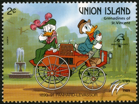 ST. VINCENT GRENADINES - UNION ISLAND - CIRCA 1989: A stamp printed in St. Vincent Grenadines shows Donald Duck and Daisy Duck, 1890-1891 Panhard-Levassor, series Disney characters in various French vehicles, circa 1989