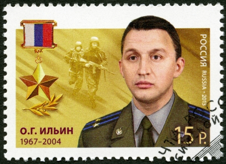 RUSSIA - CIRCA 2013: A stamp printed in Russia shows Oleg Gennadievich Ilyin (1967-2004), series Heroes of the Russian Federation, circa 2013