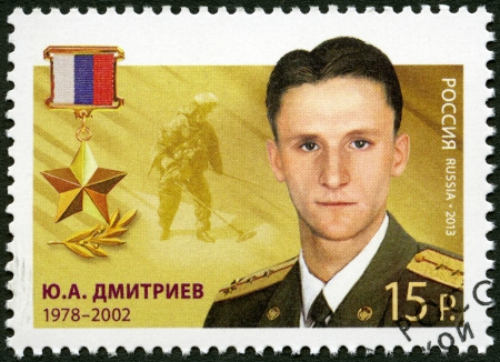 yuri: RUSSIA - CIRCA 2013: A stamp printed in Russia shows Yuri Aleksandrovich Dmitriev (1978-2002), series Heroes of the Russian Federation, circa 2013 Editorial