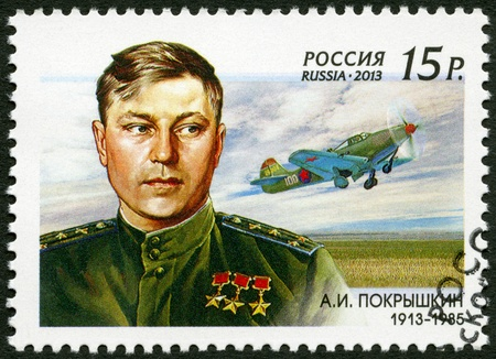 RUSSIA - CIRCA 2013: A stamp printed in Russia shows The 100th birth anniversary of A.I. Pokryshkin (1913-1985), a Soviet flying ace, circa 2013