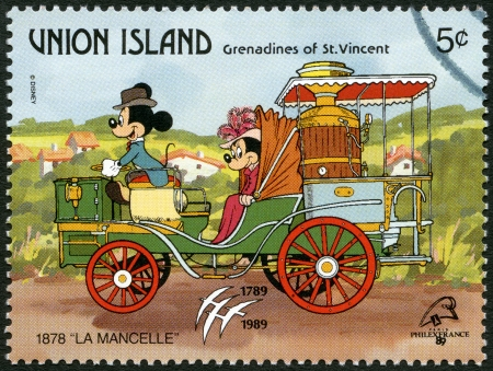 ST. VINCENT GRENADINES - UNION ISLAND - CIRCA 1989: A stamp printed in St. Vincent Grenadines shows Mickey Mouse and Minnie Mouse, 1878 La Mancelle, series Disney characters in various French vehicles, circa 1989 Stock Photo - 18330227