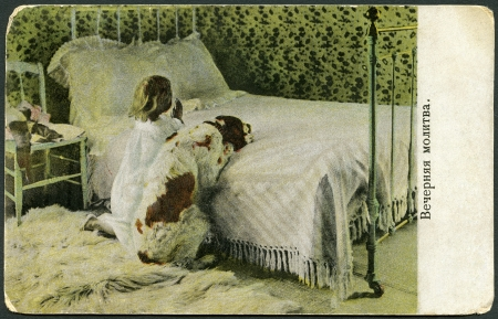 RUSSIA - CIRCA 1908  A vintage postcard printed in Russia shows Evening Prayer, Little Girl with Dog, circa 1908 Stock Photo - 18279666