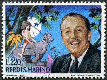 screenwriter: SAN MARINO - CIRCA 1970: A francobolli stampati in San Marino mostra Walt Disney (1901-1966) e il libro della giungla scena, fumettista e regista, circa 1970