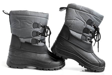 rubber sole: Children winter boot on a white background