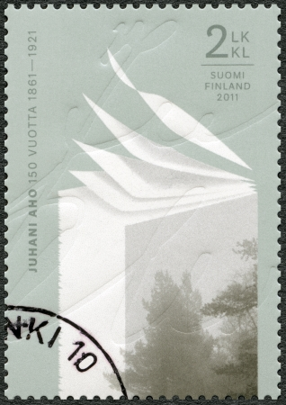 commemorate: FINLAND - CIRCA 2011: A stamp printed in Finland shows 150th Anniversary of Juhani Aho (1861-1921), circa 2011