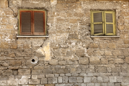 Old locked windows in vintage wall, a horizontal picture Stock Photo - 18465800