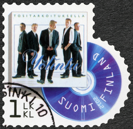 reached: FINLAND - CIRCA 2012: A stamp printed in Finland shows band Yolintu, series on Finnish music has reached the 1990s, circa 2012 Editorial