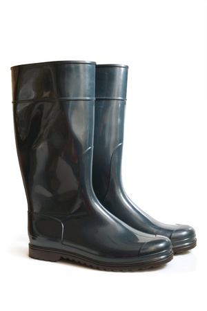 Rubber boot on a white background photo