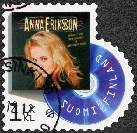 reached: FINLAND - CIRCA 2012: A stamp printed in Finland shows Anna Eriksson, series on Finnish music has reached the 1990s, circa 2012 Editorial