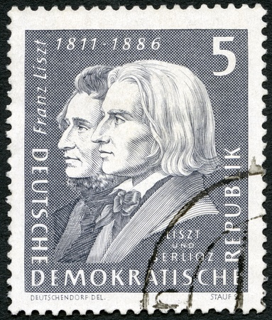 liszt: GERMANY - CIRCA 1961: A stamp printed in Germany shows Franz Liszt (1811-1886) and Hector Berlioz (1803-1869), circa 1961