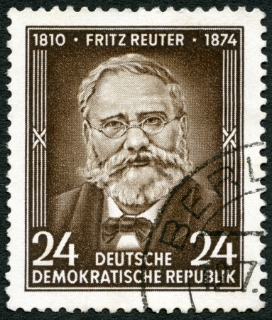 GERMANY - CIRCA 1954: A stamp printed in Germany shows Fritz Reuter (1810-1874), writer, 80th anniversary of the death, circa 1954 Stock Photo - 18777266