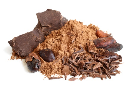 Cacao beans, cacao powder and chocolate on a white background photo