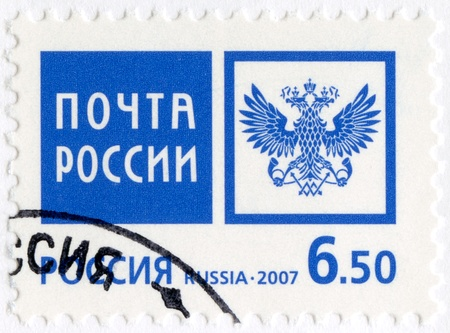 russian federation: RUSSIA - CIRCA 2007: A stamp printed in Russia shows Emblem of the Russian Post Office, circa 2007 Editorial