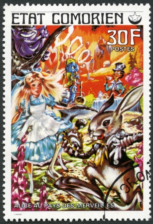 pays: COMORES - CIRCA 1976: A stamp printed in Comores shows Alice in Wonderland, series Fairy Tales, circa 1976 Editorial