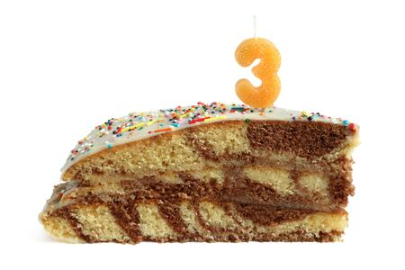 Slice of birthday cake with number three candle on a white background photo