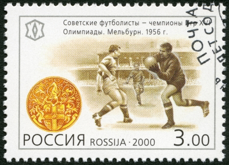 xx century: RUSSIA - CIRCA 2000: A stamp printed in Russia shows Soviet football players - the champions of the 16th sports competition, Melbourne (1956), series National Sporting Milestones of the 20th Century in Russia, circa 2000