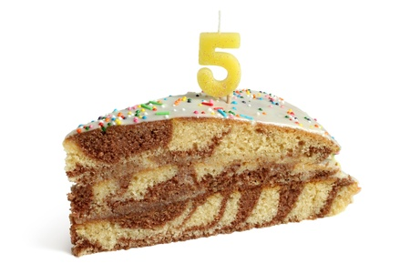 Slice of birthday cake with number five candle on a white background photo