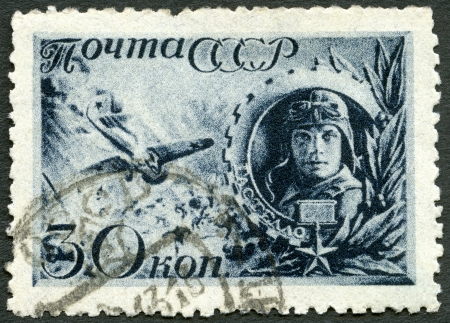 aircraft bomber: USSR - CIRCA 1942: A stamp printed in USSR shows the Captain Gastello and Burning Plane Diving into Enemy Gasoline Tanks, circa 1942