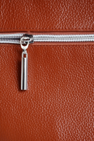 Brown leather with zipper background closeup, a vertical picture Stock Photo
