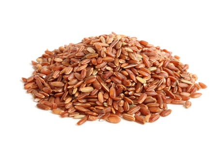 germinate: Red rice on a white background