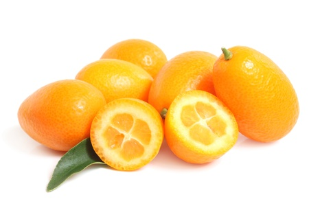 cumquat: Kumquat with leaf on a white background